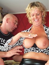 Mature couple fucking in their bedroom