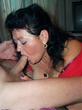 Horny mature couple fucking and sucking on the couch
