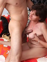 Older gal Stepahnie mouthfucks on a hard cock and gets her mature pussy and breasts fucked live