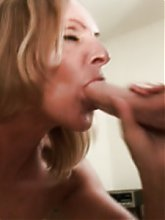 Blonde grandma Gigi got herself a young hottie and gives him a dose of her expert blowjob