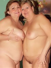 Explicit videos of chunky matures Anna and Yolanda eating each other out in the kitchen
