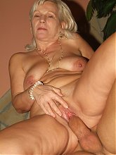 Pretty grandma with big breasts Remy showing off her assets while fucking a big cock on webcam