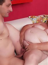 Margaret plays with her huge BBW tits while spreading her legs for a younger guy